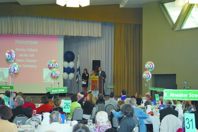 Brunch co-chairs, Sofen and Schlussel look out at the crowd while Rabbi Aaron Starr delivers the Blessing of the Elders