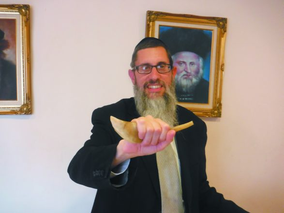 Rabbi Kaplan shows off a kosher shofar.