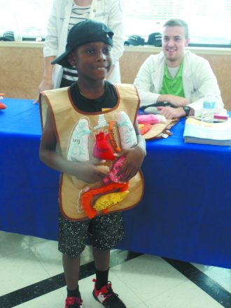 a little kid dresses in a costume that shows the intestines at a HealthyTown Everywhere event