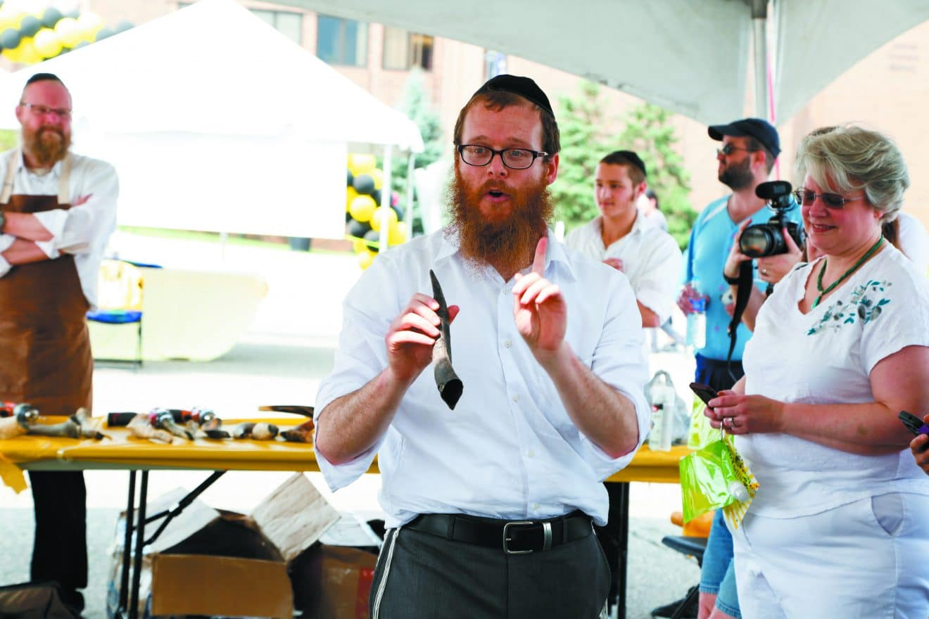 Rabbi Schneur Silberberg of the Tugman Bais Chabad Torah Center in West Bloomfield explains about the importance of the shofar to the High Holidays. The event was a partnership with the Torah Center, the JCC, PJ Library Detroit and the Janice Charach Art Gallery. At the Sherrill Brown Shofar Factory.