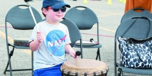 Avi Bass, 5, of West Bloomfield finds the beat.