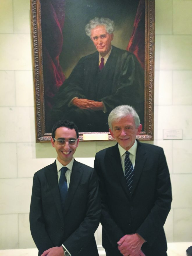 Nathan Wessler and Harold Gurewitz at the U.S. Supreme Court in front of a portrait of Louis Brandeis