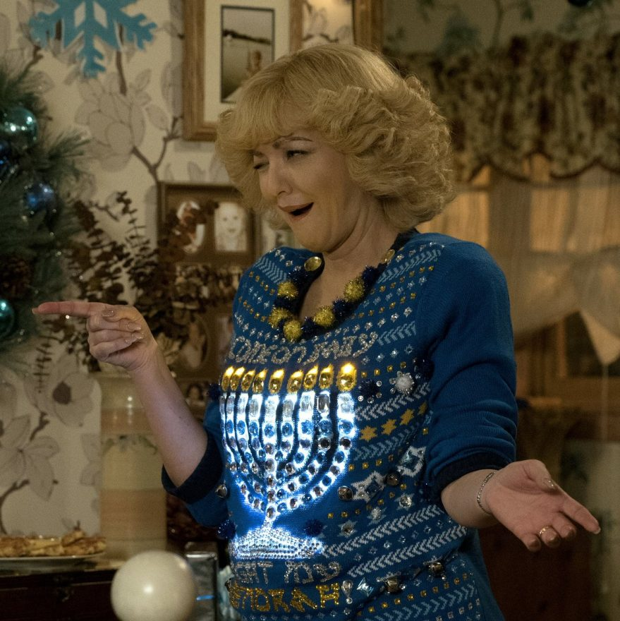 Beverly Goldberg from the ABC show The Goldbergs wears a brightly lit Hanukkah sweater that lights up a menorah.