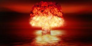 nuclear explosion over water. mushroom cloud.