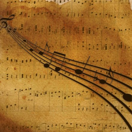 music notes on an old page of music that is tinted with age used to represent Ann Arbor Symphony Orchestra's new show Music of Faith.