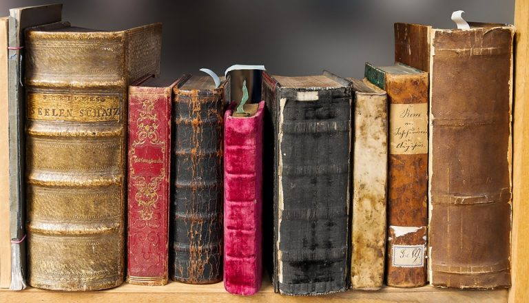 a row of old tattered books