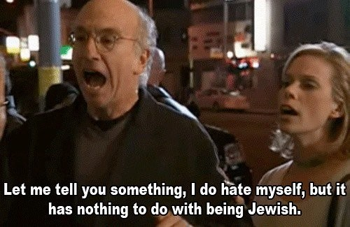 A screenshot of a gif from the show Curb Your Enthusiasm with Larry David yelling at someone off camera that reads