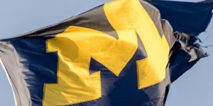 University of Michigan flag waving in the wind showing the block M