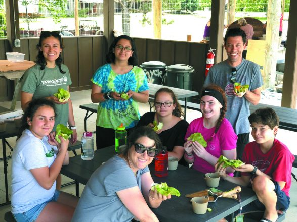 Using lettuce and other veggies from the farm, campers and staff do a taste test.