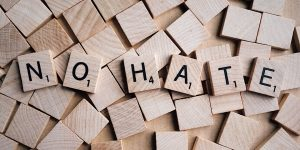 """scrabble letters reading """"no hate"""""""