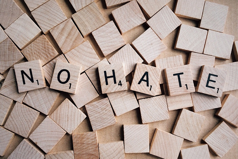 "scrabble letters reading ""no hate"""