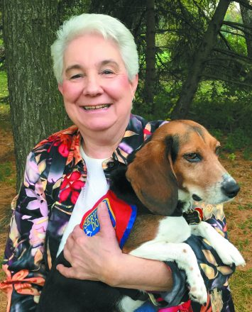 Susana Stoica with her beagle service dog