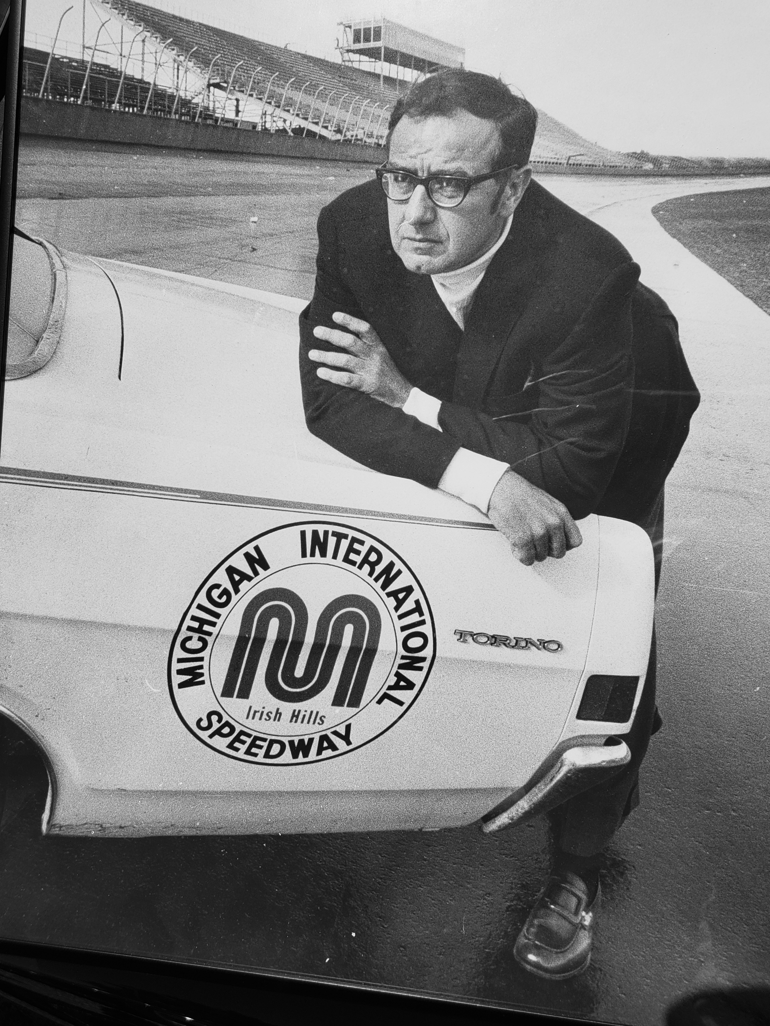 Lawrence LoPatin, seen leaning on a pace car, opened the Michigan International Speedway 50 years ago.