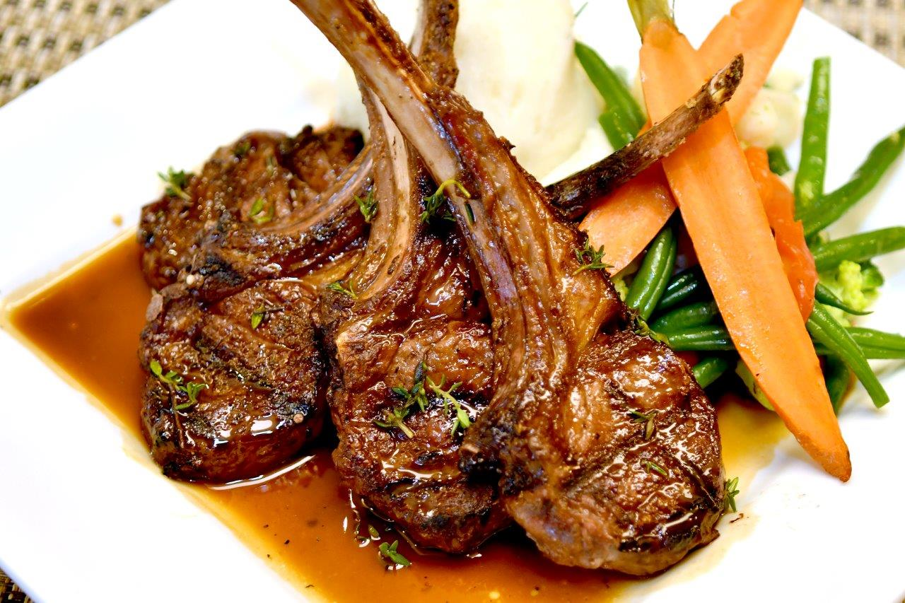 Roast Lamb Shank, including red wine demi-glace sauce, oregano, feta, scallions and onion-mashed potatoes