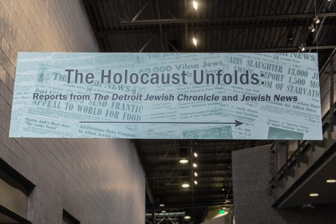 "The Holocaust Unfolds Sign reading ""The Holocaust Unforlds: Reports from The Detroit Jewish Chronicle and Jewish News"""