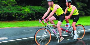 Bernstein cycles in tandem with his friend, an IDF pilot (identity obscured), during a New York City Triathalon.