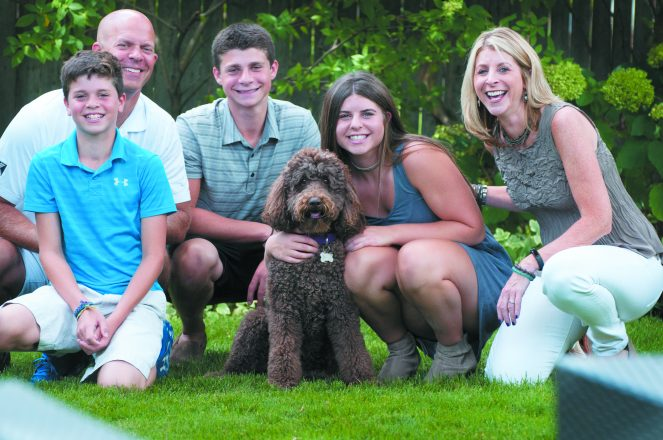 Seth, Jon, Brett, Lacey and Ellyn Davidson of Huntington Woods, with their dog, Tessa