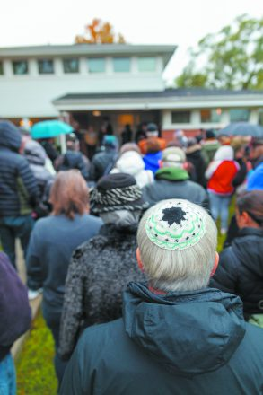 people stand at a Jewish Ferndale vigil. Close up on a man wearing a kippah.