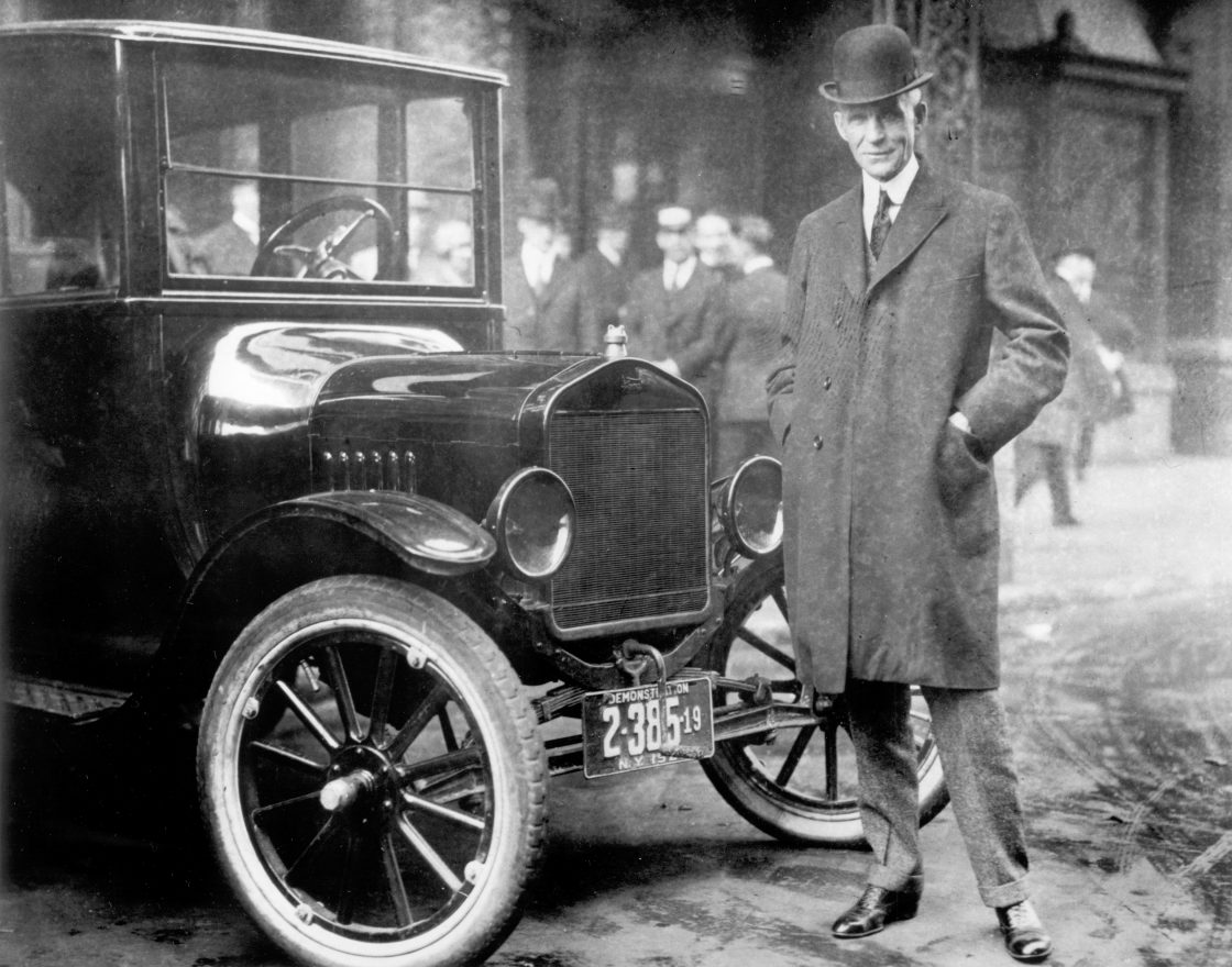 Henry Ford next to a Model T, 1921.