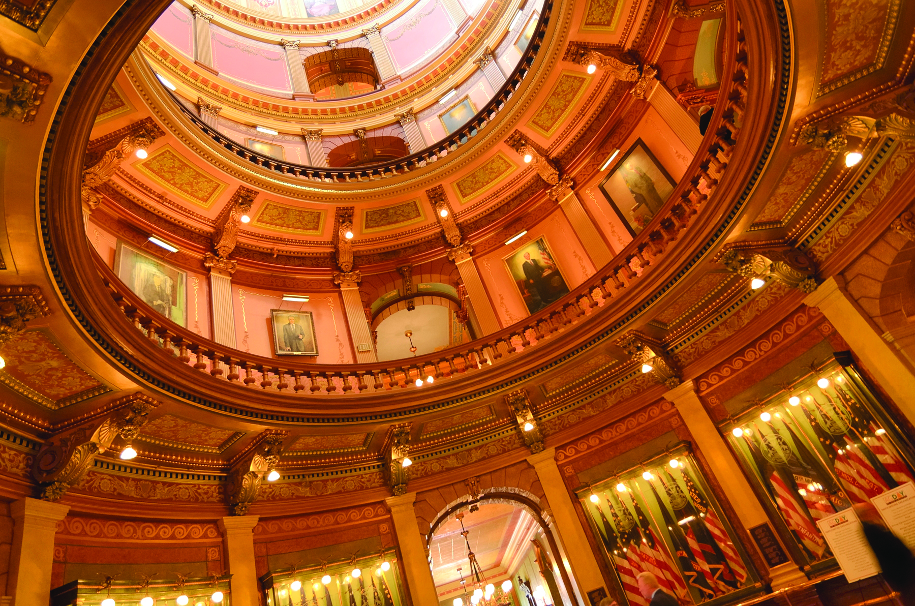Lansing, Michigan, USA - March 14, 2012: Low angle view of people inside of the public Capitol building in Lansing, the capital city of the state of Michigan.