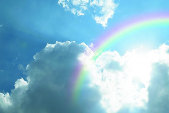 Nature cloudscape with blue sky and white cloud with rainbow