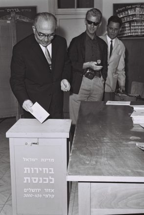Prime Minister Levi Eshkol casting his ballot in the 1965 election of the sixth Knesset.