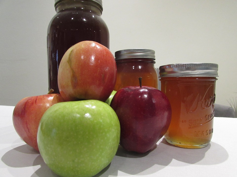 apples and honey in jars