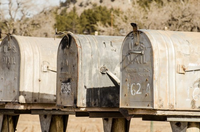 three rural mailboxes in a row