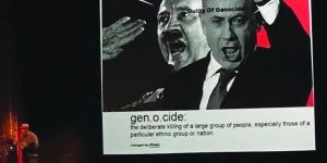 """image from Emory Douglas slide showing Benjamin Netanyahu and Adolf Hitler saying """"guilty of genocide"""" and giving a definition of genocide at the bottom of the artwork as """"the deliberate killing of a large group of people, especially those of a particular ethnic group or nation."""""""