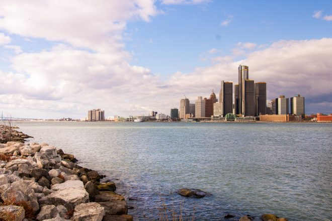 a view of the Detroit skyline from across the river.