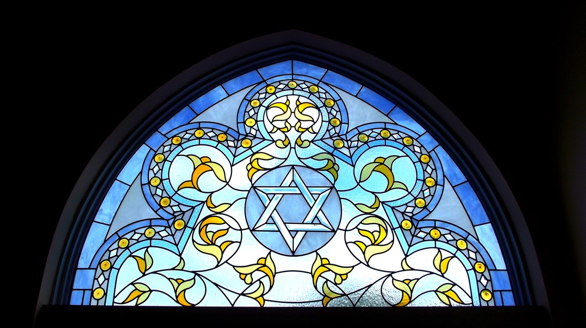 Star of David in a stained glass window in a synagogue.