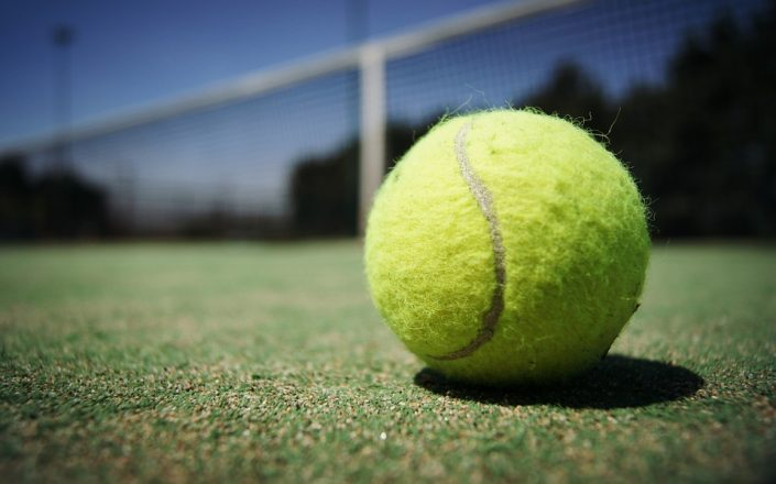 close-up on a tennis ball on a tennis court
