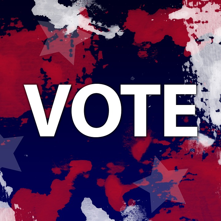 "Image of red, white and blue splotches, stars, and the word ""VOTE"""