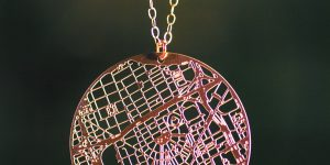 circle metal necklace pendant of the city of Detroit