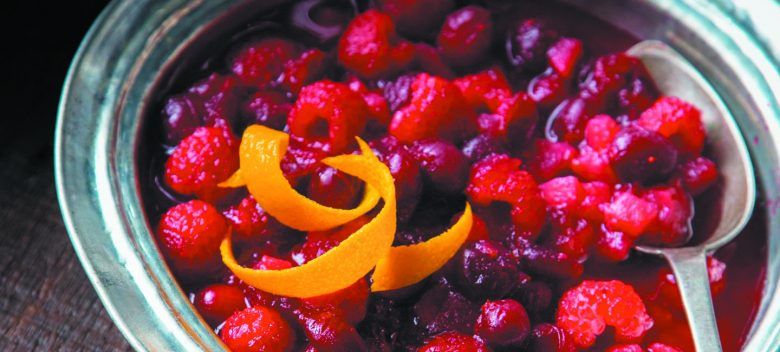 cranberry and raspberry sauce with an orange peel garnish