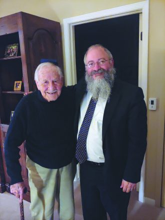 Martin Abel, 98, with Rabbi Kasriel Shemtov.