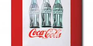 Coca Cola pop art piece with three bottles of Coke on it.