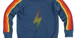 Sweater with rainbow sleeves and a rainbow lightning bolt in the center