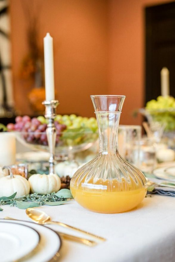 A carafe of sparkling clementine juice from Trader Joe's — a luscious addition to the table's palette.