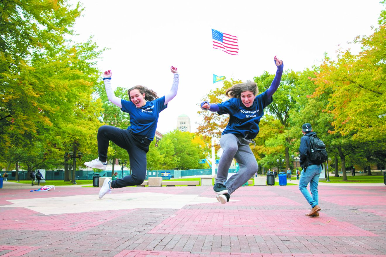 During Go Blue and White Day in support of Israel at U-M, these students show their enthusiasm.