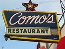 Como's restaurant sign with light up star on top.