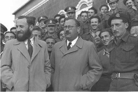 Matityahu Shmulevitz (left, with beard) and fellow Lehi leader David Yellin stand outside the Acre prison after their pardon in February 1949.