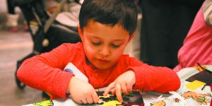 Ruby Ungar, 3, a little boy with brown hair, of Southfield is hard at work crafting.