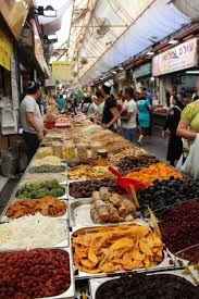Mahane Yehuda Jerusalem. Etz Hayyim street (corner of HaAfarsek street). Shuk showing rows and rows of food available for purchase.
