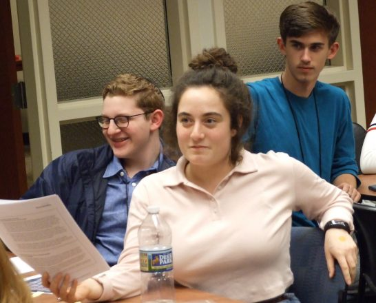 Frankel Jewish Academy sophomore Ilan Weiss (left) participates in a simulation of a Knesset legislative debate with Charlotte, N.C., sophomores Kiera Schneiderman and Max Sawyer.