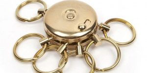 circular brass key ring holder with 6 rings to hold keys.