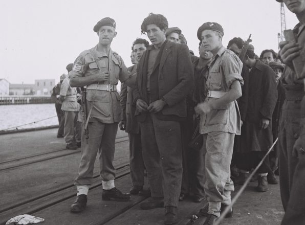 British soldiers arrest the passengers of the aliyah ship Kadima in Haifa to send them to Cyprus on Nov. 16, 1947.