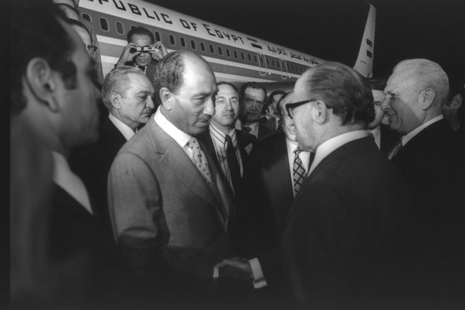Israeli Prime Minister Menachem Begin welcomes Egyptian President Anwar Sadat to Israel on Nov. 19, 1977.