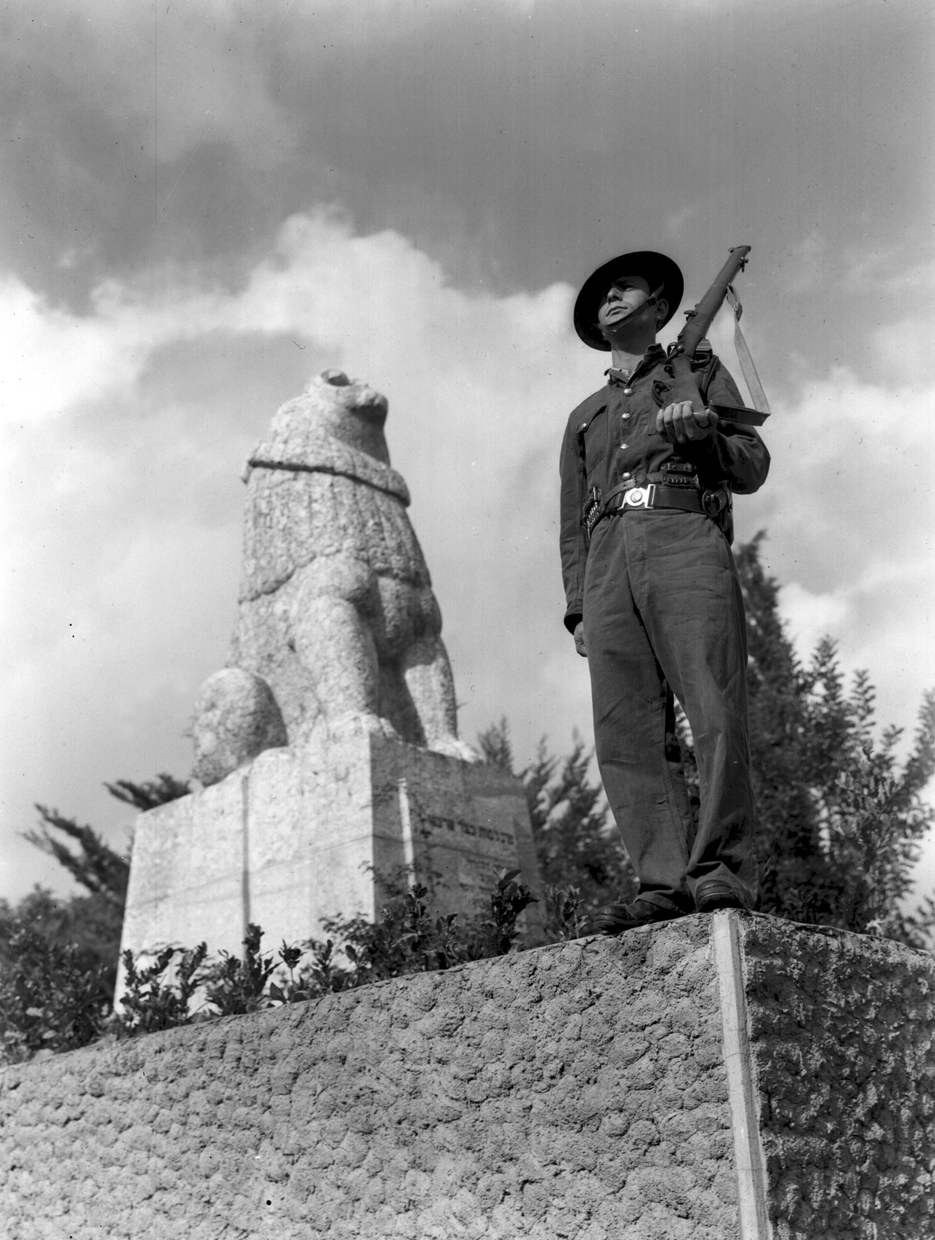 A HAGANA MEMBER STANDING ON GUARD NEAR THE TRUMPELDOR MEMORIAL AT TEL HAI.