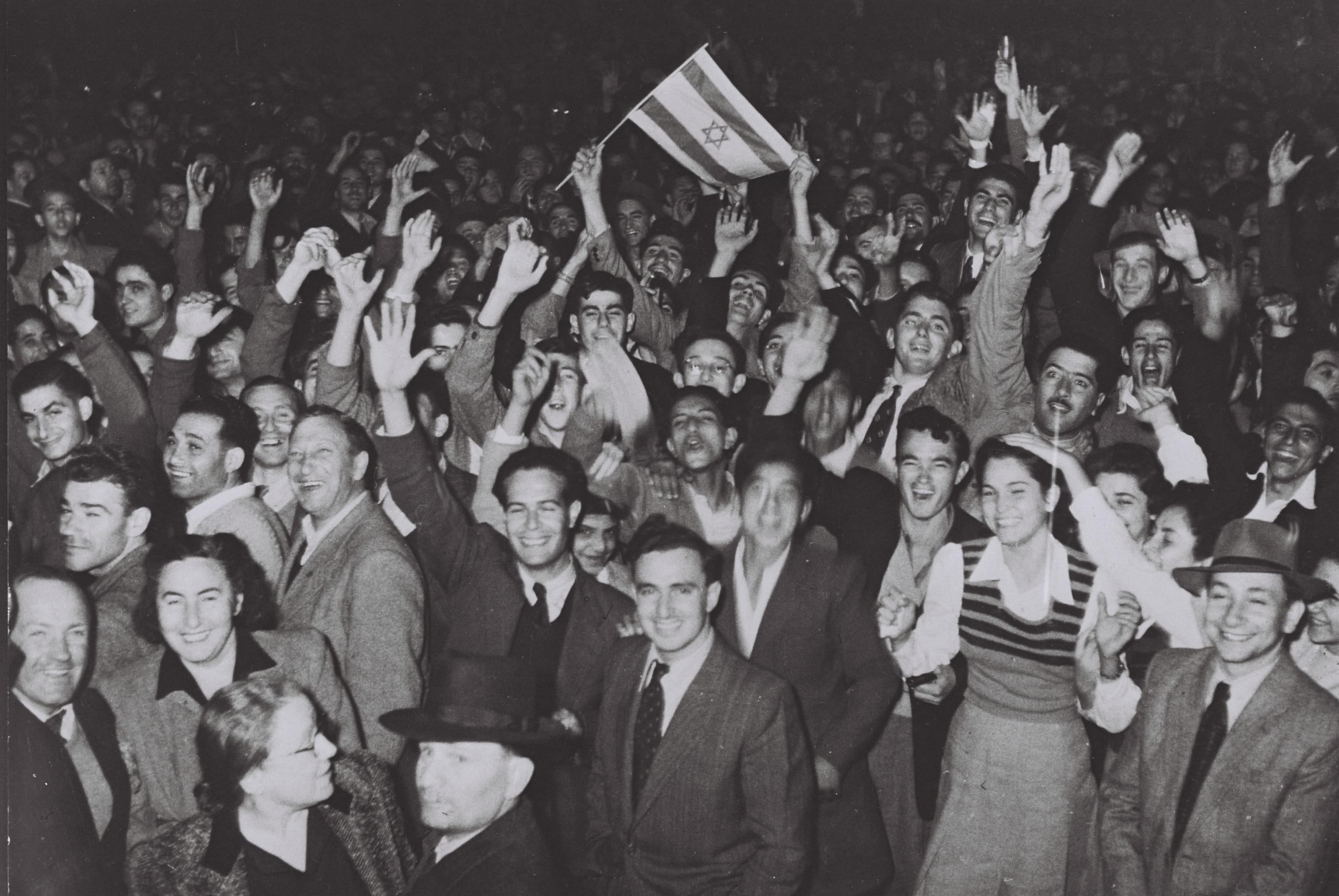 People in front of the Mugrabi Cinema in Tel Aviv celebrate the U.N. partition vote Nov. 29, 1947.